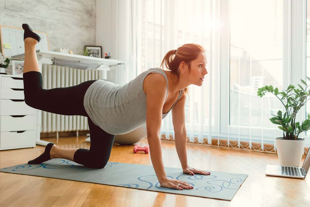 A pregnancy women is practicing yoga